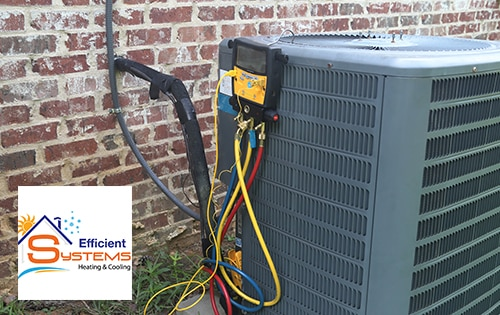 Outdoor unit of an HVAC system with a repair tool connected for diagnosing and fixing potential problems
