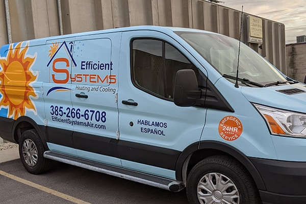 The service vehicle of Efficient Systems with the business logo and a 24-hr service sticker
