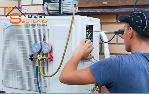 A technician repairing the outdoor unit of a home HVAC system
