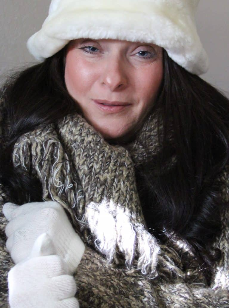 Close-up of a woman wearing a thick winter outfit due to extreme cold